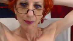 Anorexic Granny Plays With Her Hair, Showing Biceps